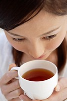 Close_up of a young woman drinking tea