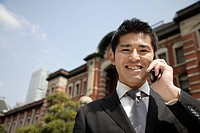 Close_up of a businessman using mobile phone