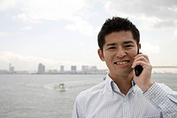Close_up of a young man using mobile phone