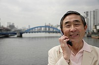 Portrait of a senior man using mobile phone