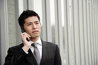 View of a young businessman using mobile phone