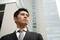 View of a young businessman looking away
