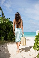 A woman walking on beach (thumbnail)
