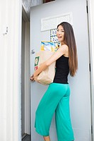 A young woman holding paper bag (thumbnail)