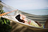 View of a young woman lying on a hammock