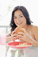 A woman holding burger