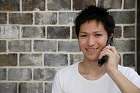 Portrait of a young man talking on mobile phone