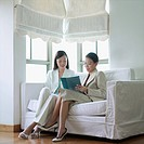 Two businesswomen reading a file