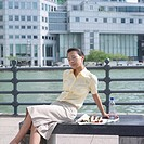Businesswoman sitting with her eyes closed