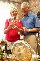 Middle aged couple shopping for antiques