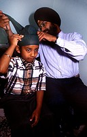 Sikh Father Tying Patak Boy Aged 7