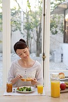 View of a young woman having breakfast