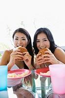 View of young women eating burger