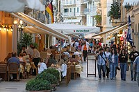 People walking through the streets and sitting in cafes, Corfu, Ionian Islands, Greece
