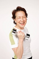 Senior woman holding dumbbell