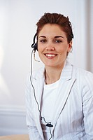 A woman with a headset.