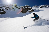 Domaine de Freeride, Zinal, A young man with telemark skis makes big turns in powder snow, canton Valais, Wallis, Switzerland, Alps, MR