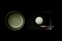 Matcha Japanese powdered green tea with cake against black background, close_up