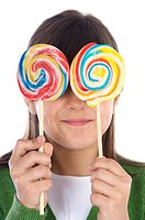 Girl eating two lollipops