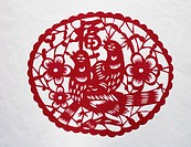 Paper_cut of two pies, flowers and Chinese characters