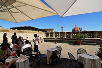 People sitting on the roof terrace of the Uffizi gallery under sunshades, Florence, Tuscany, Italy, Europe