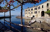 View from the terrace of the restaurant Locando San Vigilio to the lake, Punta San Vigilio, Lake Garda, Veneto, Italy, Europe