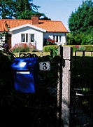 A mailbox outside a white villa Sweden.