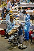 Hundreds of indigent people receive free dental care in Inglewood, CA  Note child waiting as his mother receives care  Organized by the Remote Area Me...