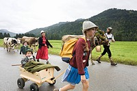 Dairy family Wachter returning from the Lenzen Alps to Balderschwang, Allgaeu, Bavaria, Germany