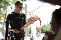 Waiter with spiny lobster, Restaurant Nikki Beach, Ramatuelle, Saint Tropez, Cote d´Azur, South of France, France, Europe