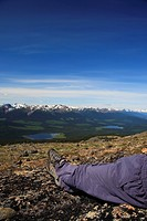 Hiker overlooking valley from Hudson Bay Mountain, Smithers, British Columbia