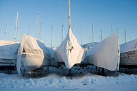 Sailing boats on land in the winter.