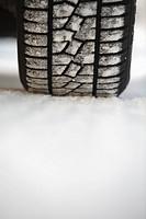 A car tire in snow.