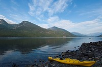 Kayaks on the shores of Slocan Lake at New Denver, British Columbia, Canada
