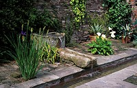 Gardens _ Water feature _ stone troughs _ Stockton Bury, Herefordshire, England