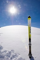 One ski on a snow covered hill