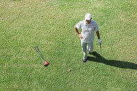 Elevated view of a man standing on golf course