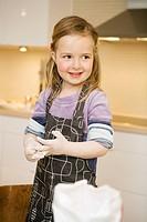 A girl baking.