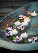 Floating candles in a bowl.