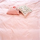 Pillows on a pink bed Sweden.