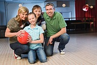 A family in a bowling alley.