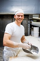 A smiling baker in a bakery Sweden.