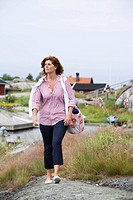 A woman walking in the archipelago of Stockholm Sweden.