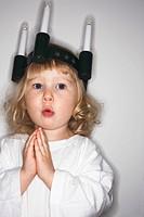 A girl celebrating Lucia Day Sweden.