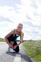 A woman fasten her shoelaces Sweden.