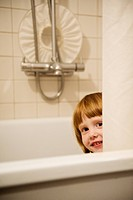 A girl playing in the bathtub Sweden.
