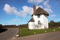 The Round House at Stanton Drew nr Bristol Somerset is a White Thatched 15th century house, which became a Toll House in the 18th century when turnpik...