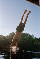 A man diving into the water Sweden.