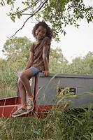 African girl sitting on trailer