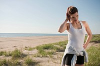 Mixed race woman in sportswear on beach